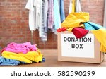 donation box with clothes on... | Shutterstock . vector #582590299