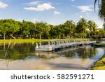 park with duck boat in river... | Shutterstock . vector #582591271