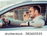 happy couple driving in car... | Shutterstock . vector #582603535