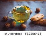 herbal tea cookies and nuts on... | Shutterstock . vector #582606415