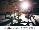 muscular man and woman pushing... | Shutterstock . vector #582612925