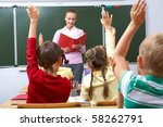 rear view of pupils raising... | Shutterstock . vector #58262791