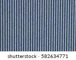 dark blue denim with teal...   Shutterstock . vector #582634771