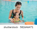 close up mother teaching kid in ... | Shutterstock . vector #582646471
