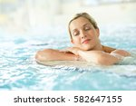 beautiful blond woman relaxing... | Shutterstock . vector #582647155