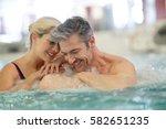 couple relaxing in...   Shutterstock . vector #582651235