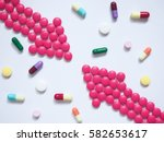 two pink arrows made by pills... | Shutterstock . vector #582653617