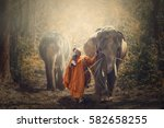 monk walking hike and wild... | Shutterstock . vector #582658255