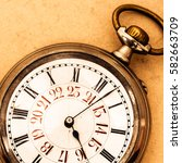 golden vintage pocket watch | Shutterstock . vector #582663709