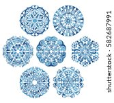 round tribal ornaments... | Shutterstock .eps vector #582687991