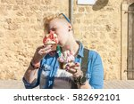 young woman with two huge cups... | Shutterstock . vector #582692101