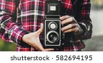 girl taking pictures outdoors... | Shutterstock . vector #582694195
