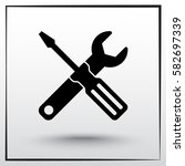 service symbol. hammer with... | Shutterstock .eps vector #582697339