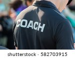 Back Of A Coach's Black Shirt...