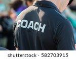 back of a coach's black shirt...
