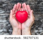 red love heart on woman's hand... | Shutterstock . vector #582707131
