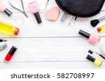 manicure set and nail polish on ... | Shutterstock . vector #582708997