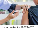 doctor woman giving a child... | Shutterstock . vector #582716575
