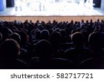 people in the auditorium... | Shutterstock . vector #582717721