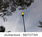 Small photo of a lamppost is standing in the middle of sky and brighten all the time