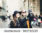 two pretty girls taking selfie  ... | Shutterstock . vector #582732235