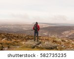 male standing on the summit of... | Shutterstock . vector #582735235