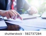businessman working with sheet... | Shutterstock . vector #582737284