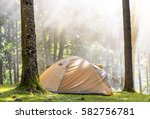 camping tent in green forest in ... | Shutterstock . vector #582756781