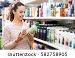 cheerful young brunette... | Shutterstock . vector #582758905