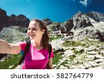 view of a girl hiking to the... | Shutterstock . vector #582764779