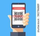 scanning qr code with... | Shutterstock .eps vector #582786889