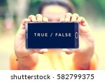 Small photo of smart phone display true or false on screen