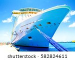cruise ship docked in tropical... | Shutterstock . vector #582824611