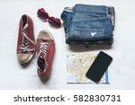essential travel accessories ... | Shutterstock . vector #582830731