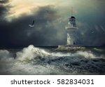 lighthouse on the sea under sky. | Shutterstock . vector #582834031