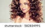 brunette  girl with long  and ... | Shutterstock . vector #582834991
