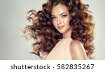 brunette  girl with long  and ... | Shutterstock . vector #582835267