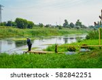 Scenic River And Fisherman. A...
