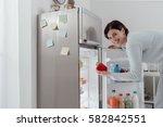 woman taking a fresh healthy... | Shutterstock . vector #582842551