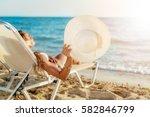 beautiful young woman enjoying... | Shutterstock . vector #582846799