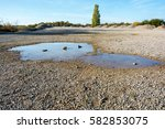 puddle after a rain in a stone... | Shutterstock . vector #582853075
