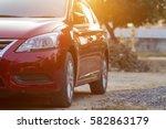 red car outdoors | Shutterstock . vector #582863179