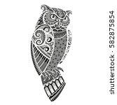 wild owl  | Shutterstock .eps vector #582875854