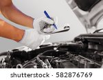 auto mechanic checking car... | Shutterstock . vector #582876769
