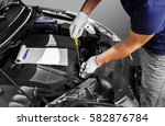 auto mechanic checking the oil... | Shutterstock . vector #582876784