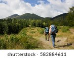 hiking in the mountains | Shutterstock . vector #582884611