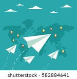 flying paper planes on the blue ... | Shutterstock .eps vector #582884641
