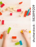 top view on child's hands... | Shutterstock . vector #582899209