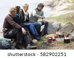 friends looking at man grinding ... | Shutterstock . vector #582902251