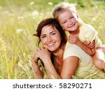 Smiling Mother And Little...